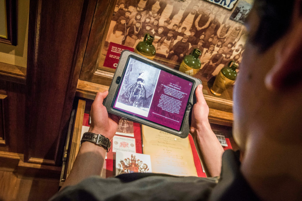 Visitor learning about Dear's whisky history with our new iPads