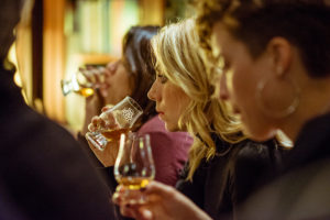 Image of guests nosing a glass of whisky